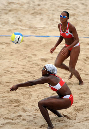 Imara Estevez (bottom) and Milagros Crespo of Cuba compete during the women's preliminary pool E of the Beijing 2008 Olympic Games beach volleyball event against Merel Mooren and Rebekka Kadijk of Netherlands in Beijing, China, Aug. 11, 2008. Imara Estevez and Milagros Crespo of Cuba won the match 2-0. (Xinhua/Sadat)