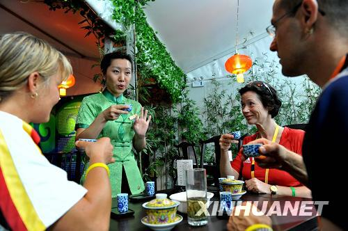German athletes get a taste of Chinese tea culture at a tea house inside the Olympic Village in Beijing on Monday, August 12, 2008. [Photo: Xinhuanet]