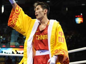 Gu Yu of China celebrates his victory over Joe Murrray of Great Britain during Men's Bantam (54kg) round of 32 at the Beijing Olympic Games boxing event in Beijing, China, Aug 12, 2008.[Xinhua]