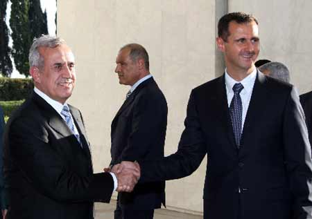 Syrian President Bashar al-Assad (R) shakes hands with his visiting Lebanese counterpart Michel Sleiman during their meeting at the Al-Shaab Presidential Palace in Damascus August 13, 2008. (Xinhua/AFP Photo)