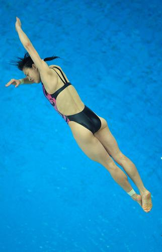 Wu Minxia competes in women's 3m springboard final on Sunday.