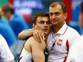 Leszek Blanik(L) of Poland celebrates with his coach after the vault performance during gymnastics artistic apparatus finals of Beijing 2008 Olympic Games at National Indoor Stadium in Beijing