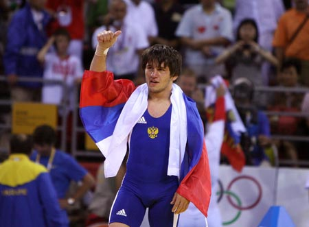 Mavlet Batirov of Russia celebrates victory during the men's freestyle 60kg gold medal match at the Beijing 2008 Olympic Games wrestling event in Beijing, China, Aug. 19, 2008. Mavlet Batirov won the bout over Vasvl Fedoryshyn of Ukraine and got the gold medal. [Xinhua]