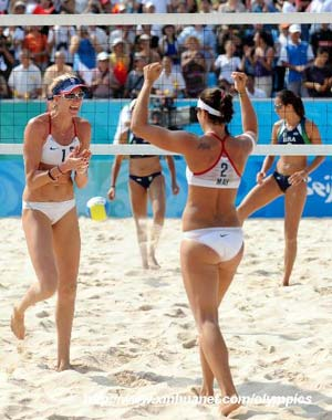 Kerri Walsh (front, L) and Misty May-Treanor of the U.S. celebrate a point during the women's semifinal of the Beijing 2008 Olympic Games beach volleyball event against Renata Ribeiro and Talita Rocha of Brazil in Beijing, China, Aug. 19, 2008.