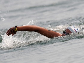 Russia's Ilchenko snatches first Olympic open water gold.