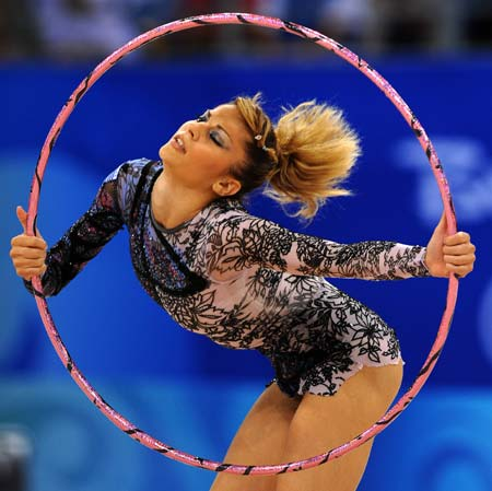 Eleni Andriola of Greece competes during the hoop contest of individual all-around qualification of Beijing Olympic Games gymnastics rhythmic event in Beijing, China, Aug. 21, 2008. (Xinhua/Cheng Min)