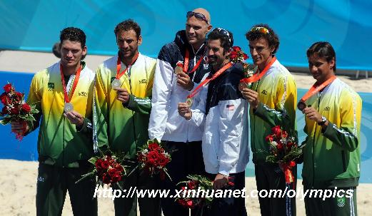 (L-R)Silver medalists Fabio Magalhaes/Marcio Araujo of Brazil, gold medalists Philip Dalhausser/Todd Rogers of the United States and bronze medalists Ricardo Santos/Emanuel Rego of Brazil pose on the podium during awarding ceremony of men's beach volleyball at the Beijing Olympic Games in Beijing, China, Aug. 22, 2008. [Gaesang Dawa/Xinhua]