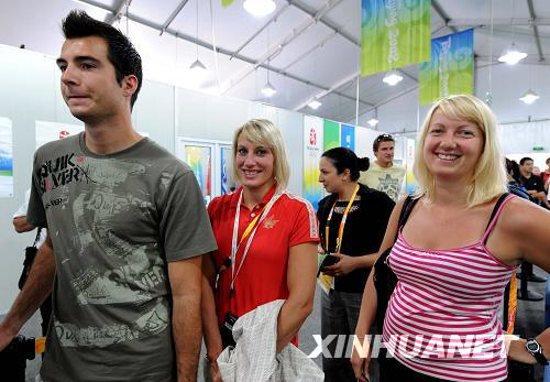 Canadian visitors wait to enter the Olympic Village on Friday, August 22, 2008. [Photo: Xinhuanet]