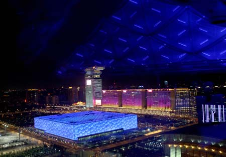Photo taken on Aug. 22, 2008 shows the nightscape of the National Aquatic Center, also known as the Water Cube, in Beijing, capital of China. The Olympic Green enjoys a beautiful night view shining with colors and lights during the Beijing 2008 Olympic Games.