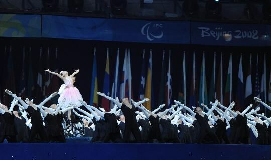 Wearing a single red ballet shoe, an 11-year-old who had her leg amputated by rescuers to save her from a collapsed school building during the May 12 earthquake stunned a capacity crowd at the Beijing Paralympic Games opening ceremony on Saturday night with an amazing wheelchair ballet performance.
