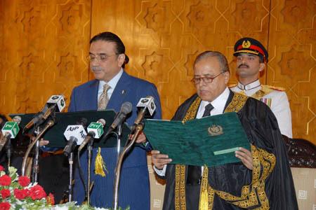 Pakistan People's Party Co-Chairman Asif Ali Zardari (L) is sworn in as Pakistan's new president in Islamabad, capital of Pakistan, Sept. 9, 2008. (Xinhua/Pakistan's Press Information Department)