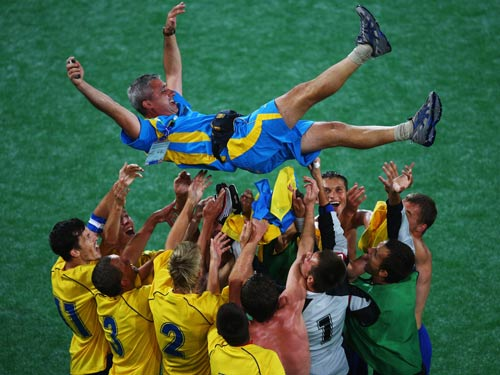 Players of Ukraine lift their coach Sergiy Ovcharenko (top) after they won. Ukraine beat Russia 2-1 in the Men's Football 7-a-side gold medal match during the Beijing 2008 Paralympic Games on September 16, 2008.