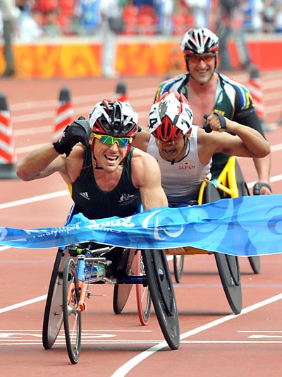 Kurt Fearnley of Australia (L) won the Men's Marathon T54 with a time of 1:23:17 during the Beijing 2008 Paralympic Games on September 17. 2008.