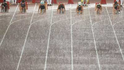 Audience's perseverence in heavy rain encourages athletes