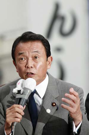 Taro Aso, one of the five candidates for Japan's Liberal Democratic Party (LDP) presidential election, addresses a campaign to exposit his political beliefs in downtown Tokyo, capital of Japan, Sept. 11, 2008.
