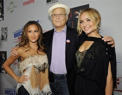 Co-hosts Norman Lear, center, and Hayden Panettiere, right, pose with Cheetah Girls singer Adrienne Bailon at Declare Yourself's 'Domino Effect' Hollywood event to encourage young people to register to vote, Wednesday, Sept. 24, 2008, in Los Angeles.