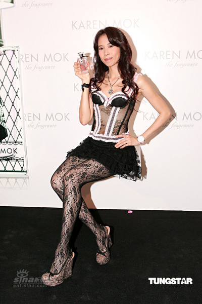 Karen Mok introduces her own brand of perfume at a press conference in Hong Kong. It is the first time that an Asian artist has released their own brand of perfume.