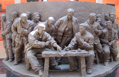A sculpture exhibited in Xiaogang Memorial Hall. On November 24, 1978, 18 Xiaogang villagers made their handprints an a household-based contract to mark the beginning of China's rural reform.