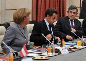 German Chancellor Angela Merkel, left, French President Nicolas Sarkozy, center, and British Prime Minister Gordon Brown, right, attend a financial crisis summit gathering Eurogroup heads of state and government at the Elysee Palace in Paris Sunday, Oct. 12, 2008.