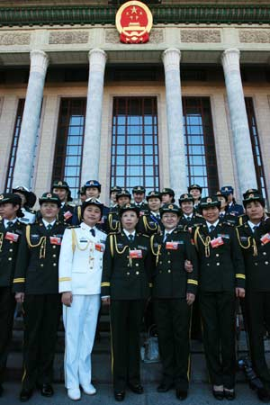 Female soldier delegates of the Tenth National Women's Congress pose for photos in front of the Great Hall of the People in Beijing, capital of China, Oct. 31, 2008. The Tenth National Women's Congress was lowered the curtain Friday. [Xinhua]