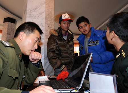 Two young men consult during a military recruitment in Lhasa, capital of southwest China's Tibet Autonomous Region Nov. 1, 2008. China's People's Liberation Army (PLA) started the yearly and nationwide winter recruitment on Saturday. [Xinhua]