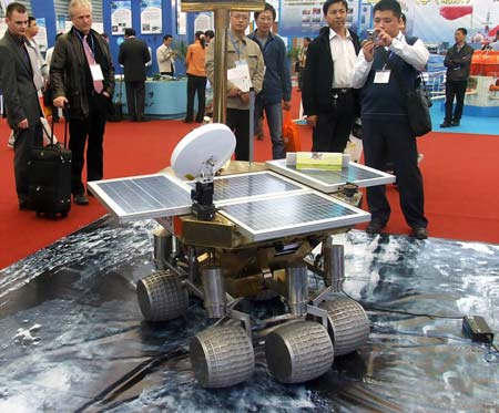"""Some visitors are attracted by a """"Moon Walker"""" designed by Beijing University of Technology at the 2008 Shanghai International Industry Fair opened in Shanghai, China, Nov. 4, 2008. Covering an area of over 120,000 square meters, the exhibition attracted a total of 1816 companies from 25 countries and regions, and served as the largest of its kind in history as the fair has come to its 10th year."""