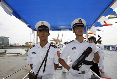 Chinese naval soldiers are seen on Chinese navy ship (CNS) Zhenghe at the Bangkok Port, Thailand, Nov. 10, 2008. CNS Zhenghe entered the Bangkok Port on Monday morning starting its four-day official visit to the Thai capital.
