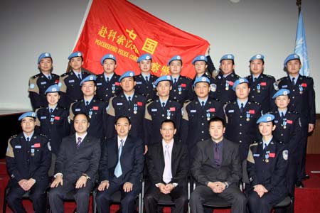 Members of the fifth contingent of Chinese police who were awarded UN peacekeeping medals pose for a group photo with the Chinese delegation in Pristina, Kosovo, Nov. 16, 2008. The fifth contingent of Chinese police personnel was awarded UN peacekeeping medals for its contributions to UN efforts to maintain peace and stability in Kosovo on Sunday.