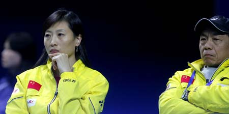 Newly-retired Olympic badminton champion Zhang Ning (L) and her former coach Tang Xuehua watch a game at the ongoing China Open Badminton event in Shanghai November 19, 2008. Zhang retained her singles title in the Beijing Olympics in August and now coaches the women's team. [Xinhua]