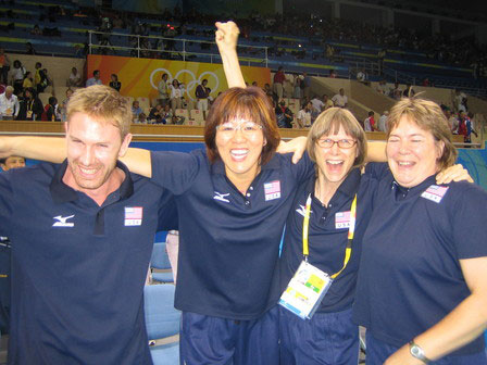 Lang Ping celebrates Team USA's victory over Cuba in the 2008 Olympic Games semifinals with Tom Hogan (left), Diane French (second to right) and Sue Woodstra (right). [USA Volleyball]