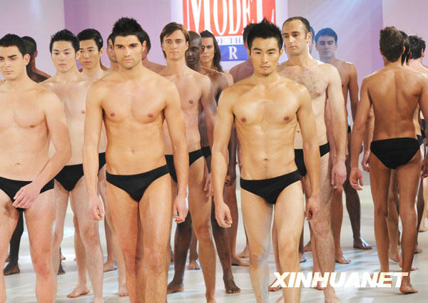 Chinese competitor Nan Fulong (front 1st R ) poses during a swimwear show of the 21st World's Best Model Contest in Istanbul, Turkey, early Dec. 7, 2008.