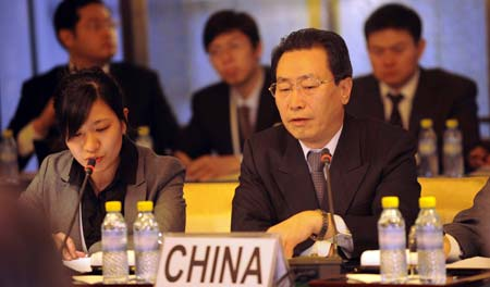 Chinese top nuclear negotiator and Vice Foreign Minister Wu Dawei (1st R, front) addresses a fresh round of talks on the denuclearization of the Democratic People's Republic of Korea (DPRK) in the Diaoyutai State Guesthouse in Beijing, on Dec. 8, 2008.