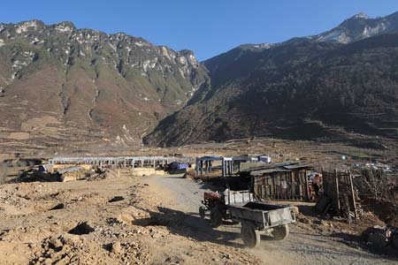 Photo taken on Dec. 8, 2008 shows the construction site in Luobozhai Village of Yanmen Township, the quake-hit Wenchuan County, southwest China's Sichuan Province. Luobozhai, less than 10 kilometers from the county seat, is the biggest Qiang ethnic village existing in China.[Xinhua]