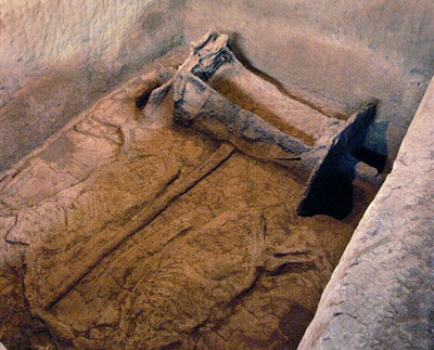 Remains of a chariot and two horses can be seen inside the tomb.