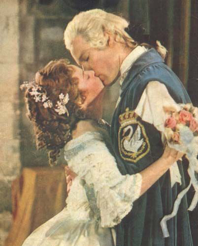 A kissing still from the English movie 'The Slipper and the Rose'.