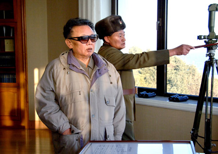Kim Jong Il (Front), top leader of the Democratic People's Republic of Korea (DPRK), inspects Unit 1489 under the Artillery Command of the Korean People's Army in this undated picture released by Korean Central News Agency of the DPRK (KCNA) on Jan. 5, 2009. [Xinhua]
