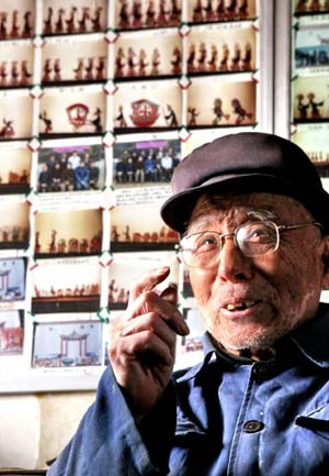 Farmer He Fulin, a shadow-play lover, talks about the shadow-play at home in Funing County, north China's Hebei Province, Jan. 11, 2009. Devoting himself to making, collecting and playing shadow-play, a Chinese traditional art, for more than 70 years, He has decided to pass it down to young people.[Liu Xuezhong/Xinhua]