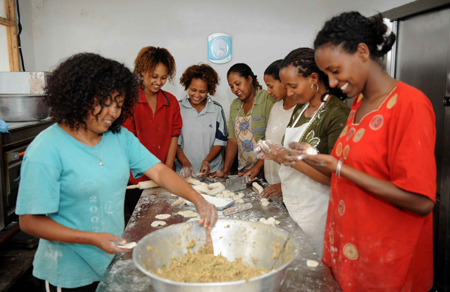 Ethiopian workers of China's ZTE Corporation make Chinese dumplings as they celebrate the Chinese Lunar New Year with Chinese workers in Addis Ababa, capital of Ethiopia, Jan. 25, 2009.