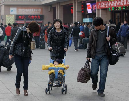 Passengers walk out of the Beijing railway station in Beijing, capital of China, Feb. 9, 2009. China's railways would undergo the second post-festival travel peak since Monday which was also the traditional Chinese Lantern Festival, the Ministry of Railways (MOR) said. [Xinhua/Xing Guangli]