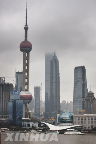 Photo taken on February 26, 2009 shows a cloudy day in Shanghai. Rain clouds have been showering Shanghai for the past 20 days, smashing a 136-year record for the longest continuous downpour.