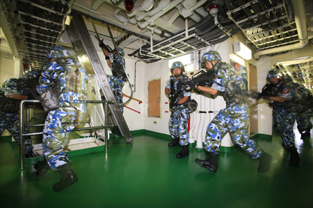 Chinese marine special force corps attend a drill on board of destroyer 'Guangzhou' in the Indian Ocean on the way to Pakistan March 4, 2009. A Chinese naval task force including destroyer 'Guangzhou' and a helicopter will attend the 'Peace-09' exercise in the seas off Pakistan.