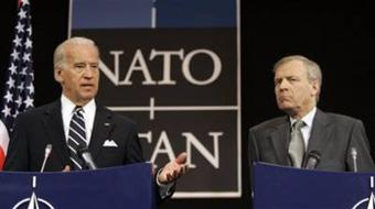 U.S. Vice President Joe Biden, left, gestures while speaking during a media conference at NATO headquarters in Brussels, Tuesday March 10, 2009.[Virginia Mayo/CCTV/AP Photo]