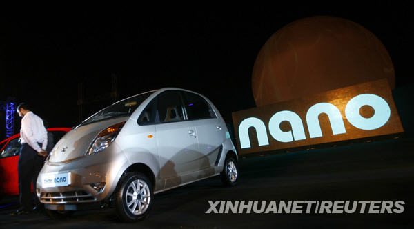 Tata Nano car is seen during the vehicle's launch in Mumbai on March 23, 2009. Tata Motors took the wraps off the world's cheapest car, showcasing the Nano that bosses hope will transform travel for millions of Indians at a glitzy, open-air launch. The basic model -- bookings for which open next month -- sells for just 100,000 rupees (2,000 USD). [Xinhua/Reuters]