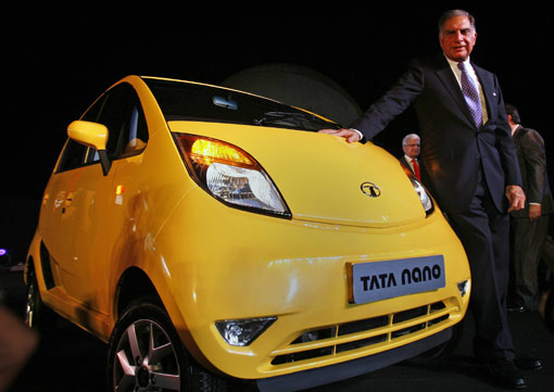 Tata Nano car is seen during the vehicle's launch in Mumbai on March 23, 2009. Tata Motors took the wraps off the world's cheapest car, showcasing the Nano that bosses hope will transform travel for millions of Indians at a glitzy, open-air launch. The basic model -- bookings for which open next month -- sells for just 100,000 rupees (2,000 USD). [Xinhua/AFP]