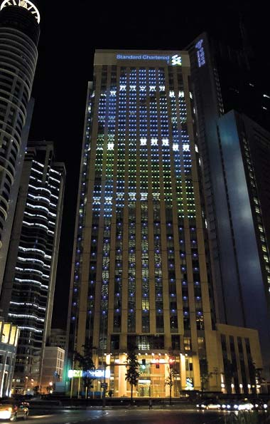 The 28-story Standard Chartered Tower in Pudong, the bank's headquarters, will go dark on Earth Hour. [Shanghai Daily]