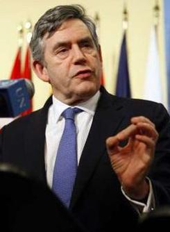 Britain's Prime Minister Gordon Brown gestures as he speaks during a news conference with U.N. [Chip East/CCTV/REUTERS]