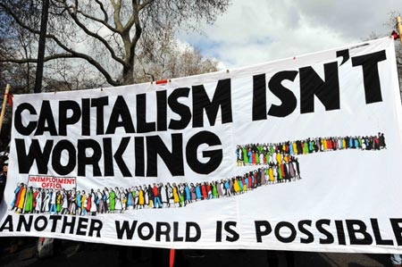 A banner is displayed during a demonstration in London on March 28, 2009. The Put People First group, an alliance of more than 150 unions, on Saturday organized the demonstration, calling on the leaders of the Group of 20 Countries (G20) to adopt sustainable policies that can lead the world out of recession. The demonstrators also urged the leaders to attach importance to global environment protection and to stablize the world political situation. (Xinhua/Zhang Liqing)