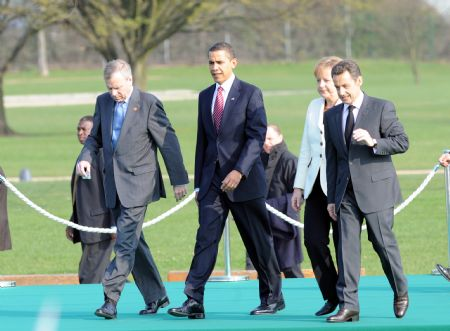 (L-R) NATO Secretary General Jaap de Hoop Scheffer, U.S. President Barack Obama, German Chancellor Angela Merkel and French President Nicolas Sarkozy reach France after crossing German-French border bridge, Passerelle Bridge, which connected German city Kehl and French city Strasbourg, on April 4, 2009. Leaders of NATO member states held a symbolic ceremony on the French-German border on Saturday to celebrate the 60th anniversary of the military alliance and the return of France as a full member.