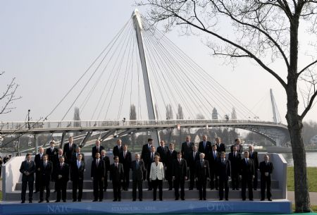 Leaders of NATO member states take a family photo after crossing German-French border bridge, Passerelle Bridge, which connected German city Kehl and French city Strasbourg, in Strasbourg, France, on April 4, 2009. Leaders of NATO member states held a symbolic ceremony on the French-German border on Saturday to celebrate the 60th anniversary of the military alliance and the return of France as a full member.