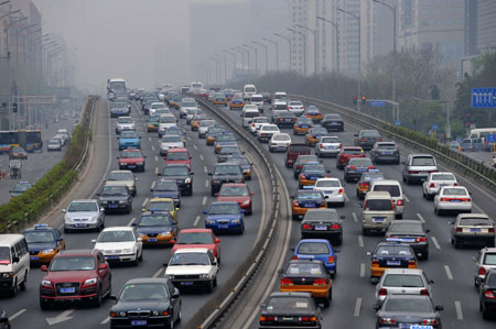 Cars run on an overpass in Beijing, capital of China, on April 11, 2009. A series of vehicle restrictions will be carried out from April 11, 2009 to April 10, 2010 in an effort to ease traffic congestion and reduce air pollution. [Xinhua]